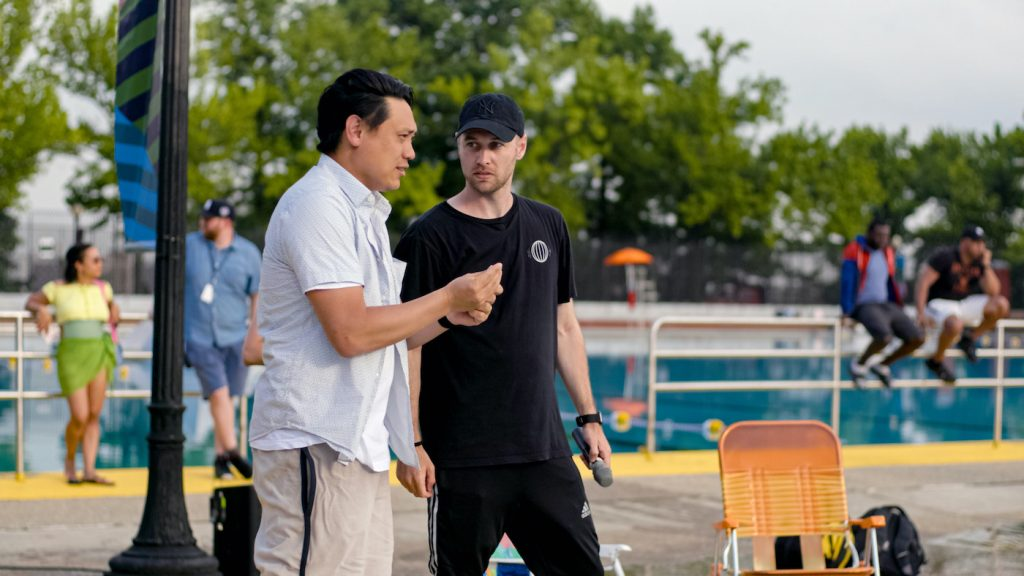 """(L-r) Director JON M. CHU and choreographer CHRISTOPHER SCOTT on the set of Warner Bros. Pictures' """"IN THE HEIGHTS,"""" a Warner Bros. Pictures release. Courtesy Warner Bros."""
