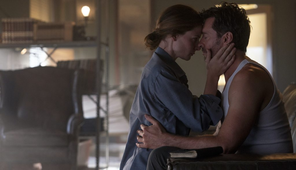 """Caption: (L-r) REBECCA FERGUSON as Mae and HUGH JACKMAN as Nick Bannister in Warner Bros. Pictures' action thriller """"REMINISCENCE,"""" a Warner Bros. Pictures release. Photo Credit: Ben Rothstein"""