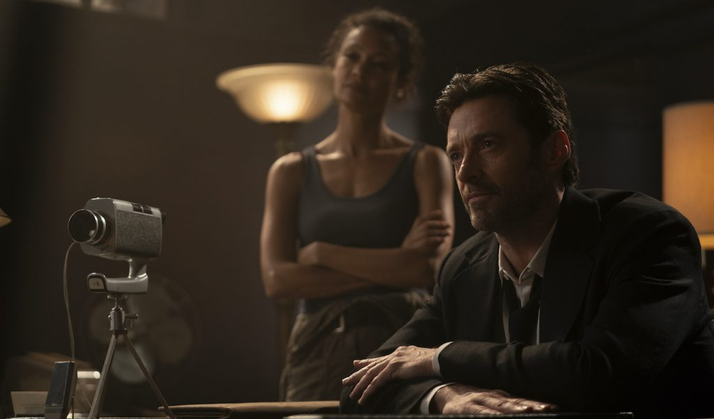 """Caption: (L-r) THANDIWE NEWTON as Watts and HUGH JACKMAN as Nick Bannister in Warner Bros. Pictures' action thriller """"REMINISCENCE,"""" a Warner Bros. Pictures release. Photo Credit: Ben Rothstein"""