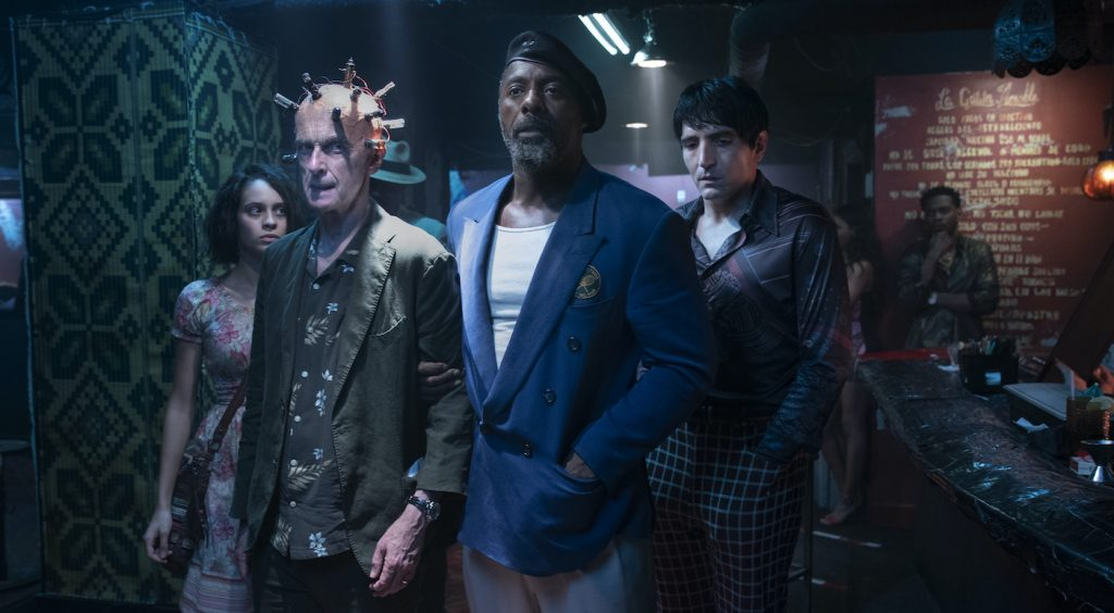 """Caption: (L-r) DANIELA MELCHIOR as Ratcatcher 2, PETER CAPALDI as The Thinker, IDRIS ELBA as Bloodsport and DAVID DASTMALCHIAN as Polka Dot Man in Warner Bros. Pictures' action adventure """"THE SUICIDE SQUAD,"""" a Warner Bros. Pictures release. Photo Credit: Jessica Miglio/™ & © DC Comics"""