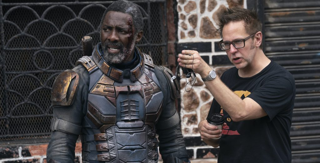 """Caption: (L-r) IDRIS ELBA and writer/director JAMES GUNN on the set of Warner Bros. Pictures' action adventure """"THE SUICIDE SQUAD,"""" a Warner Bros. Pictures release. Photo Credit: Jessica Miglio/™ & © DC Comics"""