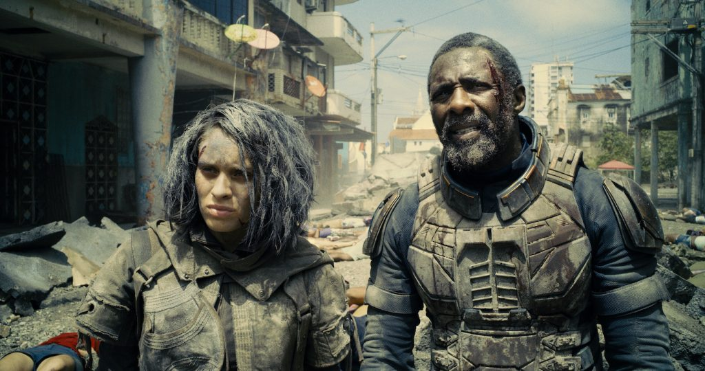 """Caption: (L-r) DANIELA MELCHIOR as Ratcatcher 2 and IDRIS ELBA as Bloodsport in Warner Bros. Pictures' superhero action adventure """"THE SUICIDE SQUAD,"""" a Warner Bros. Pictures release. Photo Credit: Courtesy of Warner Bros. Pictures/™ & © DC Comics"""