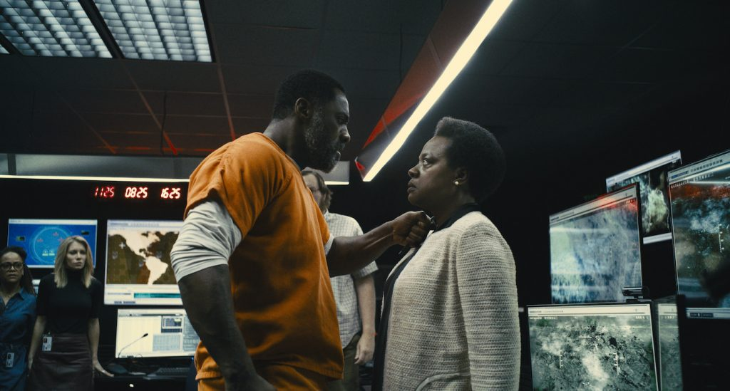 """Caption: (L-r) IDRIS ELBA as Bloodsport and VIOLA DAVIS as Amanda Waller in Warner Bros. Pictures' superhero action adventure """"THE SUICIDE SQUAD,"""" a Warner Bros. Pictures release. Photo Credit: Courtesy of Warner Bros. Pictures/™ & © DC Comics"""