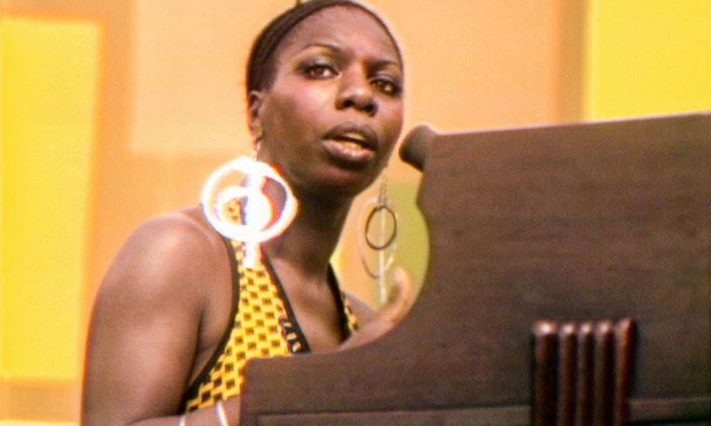Nina Simone performs at the Harlem Cultural Festival in 1969, featured in the documentary SUMMER OF SOUL. Photo Courtesy of Searchlight Pictures. © 2021 20th Century Studios All Rights Reserved