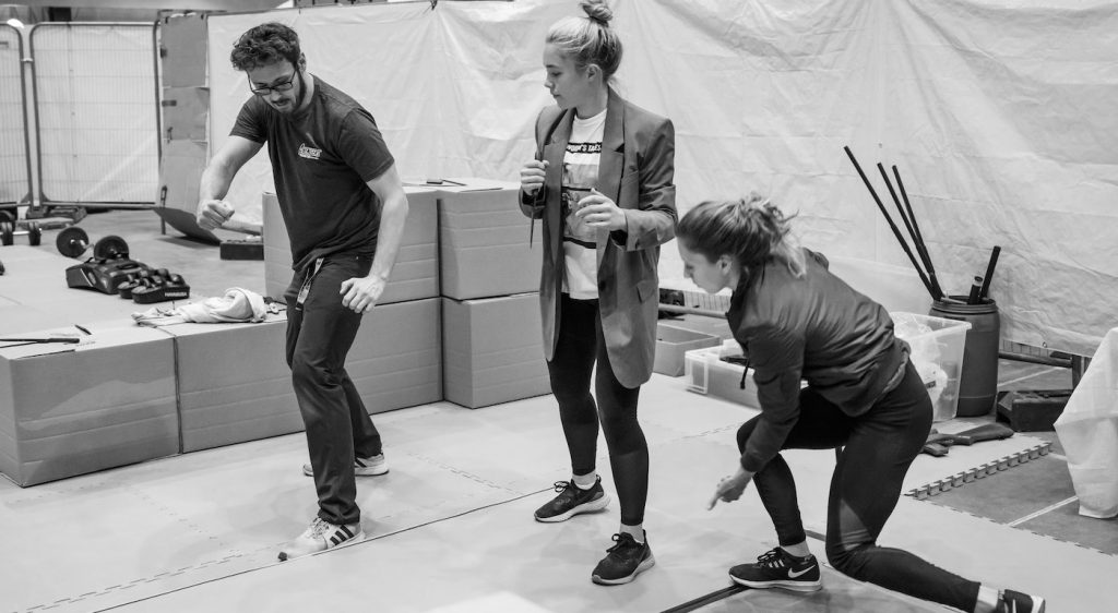 (L-R): Stunt coordinator Rob Inch, Florence Pugh and stunt double on the set of Marvel Studios' BLACK WIDOW, in theaters and on Disney+ with Premier Access. Photo by Jay Maidment. ©Marvel Studios 2021. All Rights Reserved