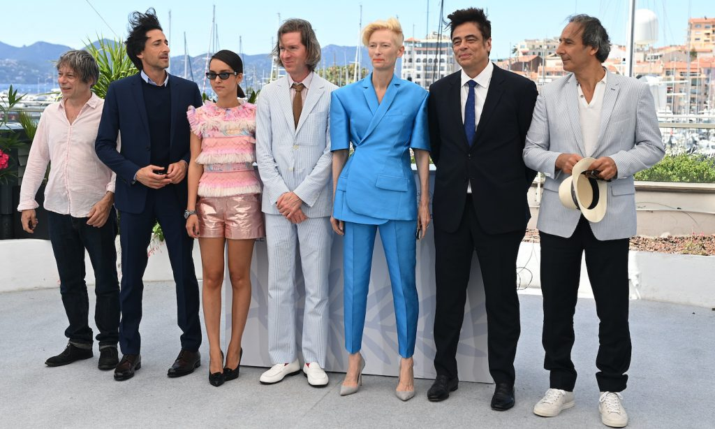 """CANNES, FRANCE - JULY 13: (L-R) Mathieu Amalric, Adrien Brody, Lyna Khoudri, Wes Anderson, Tilda Swinton, Benicio Del Toro and Alexandre Desplat attend the """"The French Dispatch"""" photocall during the 74th annual Cannes Film Festival on July 13, 2021 in Cannes, France. (Photo by Kate Green/Getty Images)"""