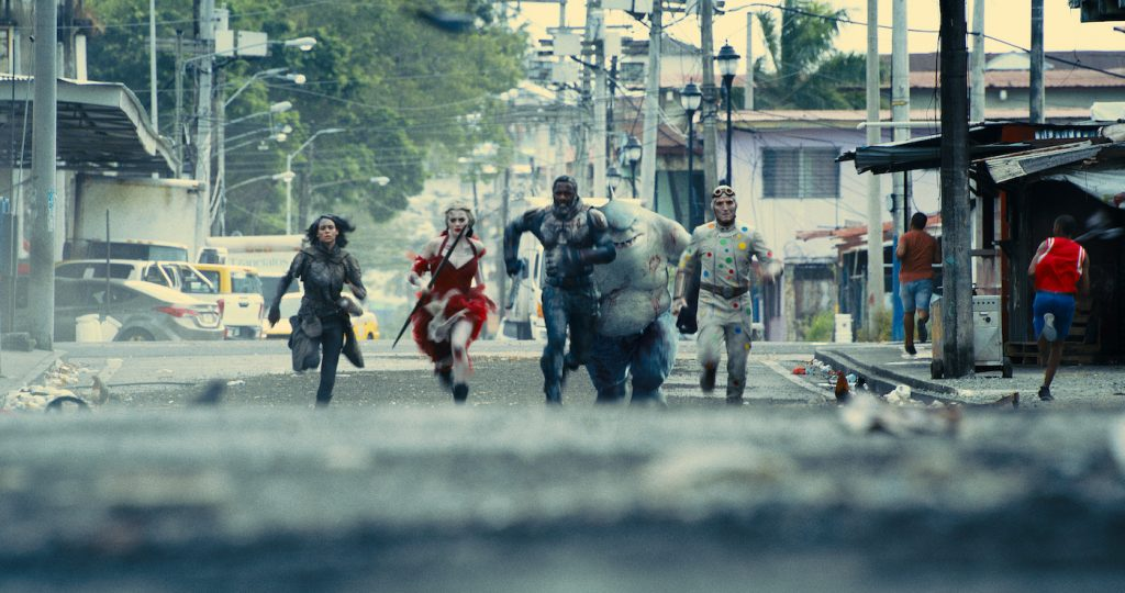 """Caption: (L-r) DANIELA MELCHIOR as Ratcatcher 2, MARGOT ROBBIE as Harley Quinn, IDRIS ELBA as Bloodsport, KING SHARK and DAVID DASTMALCHIAN as Polka-Dot Man in Warner Bros. Pictures' superhero action adventure """"THE SUICIDE SQUAD,"""" a Warner Bros. Pictures release. Photo Credit: Courtesy of Warner Bros. Pictures/™ & © DC Comics"""