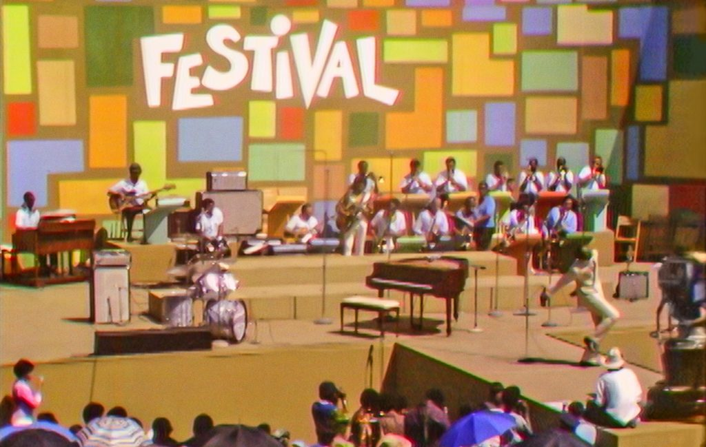 Tony Lawrence hosts the Harlem Cultural Festival in 1969, featured in the documentary SUMMER OF SOUL. Photo Courtesy of Searchlight Pictures. © 2021 20th Century Studios All Rights Reserved