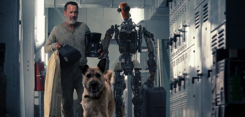 """A man (played by Tom Hanks), a dog and a robot (played by Caleb Landry Jones) form an unlikely family In """"Finch,"""" premiering exclusively on Apple TV+ on Friday, November 5."""