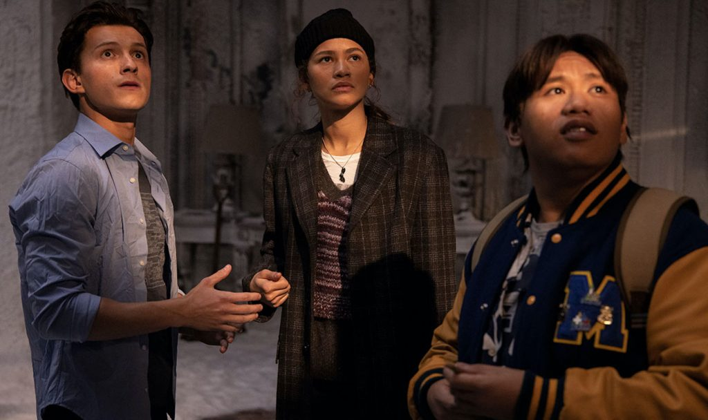 """L-r: Peter Parker (Tom Holland), MJ (Zendaya), and Ned (Jacob Batalon) in """"Spider-Man: No Way Home."""" Courtesy Sony Pictures."""
