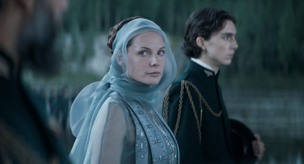 """Caption: (L-r) REBECCA FERGUSON as Lady Jessica and TIMOTHÉE CHALAMET as Paul Atreides in Warner Bros. Pictures' and Legendary Pictures' action adventure """"DUNE,"""" a Warner Bros. Pictures release. Photo Credit: Courtesy of Warner Bros. Pictures and Legendary Pictures"""