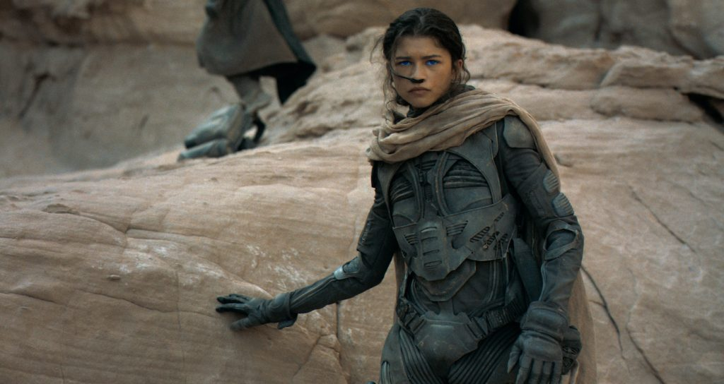 """Caption: ZENDAYA as Chani in Warner Bros. Pictures' and Legendary Pictures' action adventure """"DUNE,"""" a Warner Bros. Pictures release. Photo Credit: Courtesy of Warner Bros. Pictures and Legendary Pictures"""