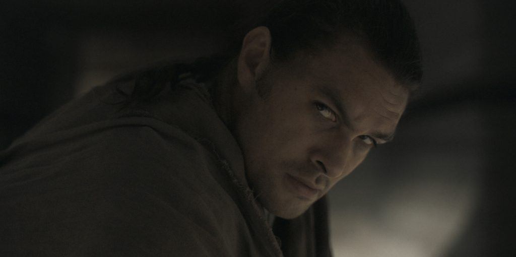 """Caption: JASON MOMOA as Duncan Idaho in Warner Bros. Pictures' and Legendary Pictures' action adventure """"DUNE,"""" a Warner Bros. Pictures release. Photo Credit: Courtesy of Warner Bros. Pictures and Legendary Pictures"""