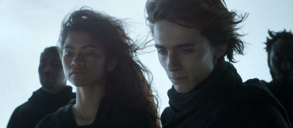 """Caption: (L-r) ZENDAYA as Chani and TIMOTHÉE CHALAMET as Paul Atreides in Warner Bros. Pictures' and Legendary Pictures' action adventure """"DUNE,"""" a Warner Bros. Pictures and Legendary release. Photo Credit: Courtesy of Warner Bros. Pictures and Legendary Pictures"""