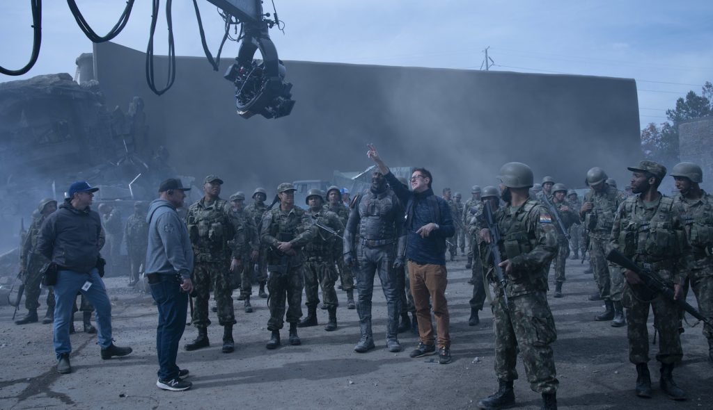 """Caption: (Center) IDRIS ELBA and writer/director JAMES GUNN on the set of Warner Bros. Pictures' action adventure """"THE SUICIDE SQUAD,"""" a Warner Bros. Pictures release. Photo Credit: Jessica Miglio/™ & © DC Comics"""