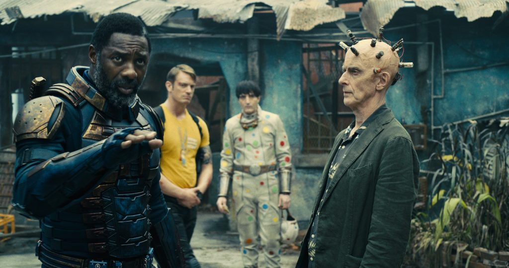 """Caption: (L-r) IDRIS ELBA as Bloodsport, JOEL KINNAMAN as Colonel Rich Flag, DAVID DASTMALCHIAN as Polka-Dot Man and PETER CAPALDI as Thinker in Warner Bros. Pictures' superhero action adventure """"THE SUICIDE SQUAD,"""" a Warner Bros. Pictures release. Photo Credit: Courtesy of Warner Bros. Pictures/™ & © DC Comics"""