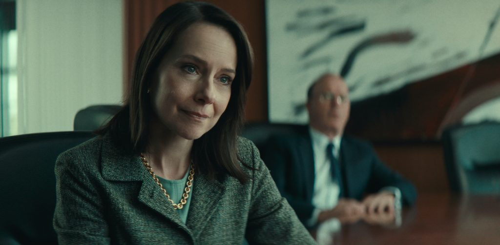 WORTH (2021) Amy Ryan as Camille Biros and Michael Keaton as Ken Feinberg. Cr: NETFLIX