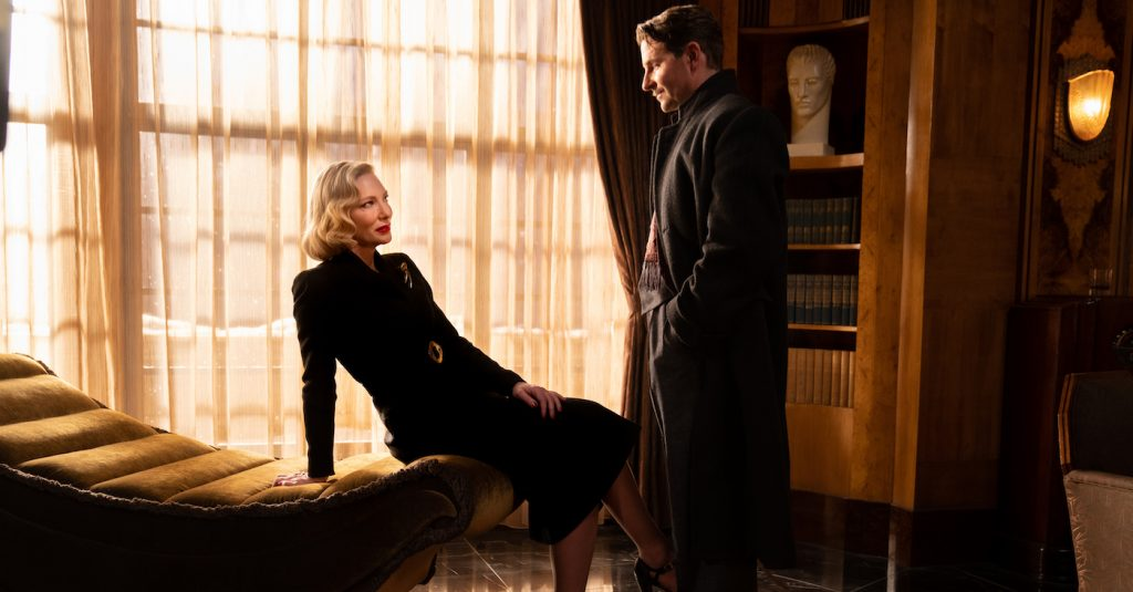 Cate Blanchett and Bradley Cooper in the film NIGHTMARE ALLEY. Photo by Kerry Hayes. © 2021 20th Century Studios All Rights Reserved