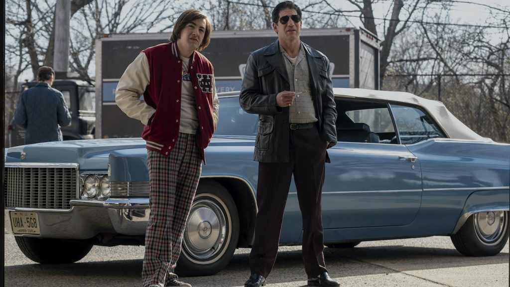 """(L-r) MICHAEL GANDOLFINI as Teenage Tony Soprano and JON BERNTHAL as Johnny Soprano in New Line Cinema and Home Box Office's mob drama """"THE MANY SAINTS OF NEWARK,"""" a Warner Bros. Pictures release. Photo by Barry Wetcher."""