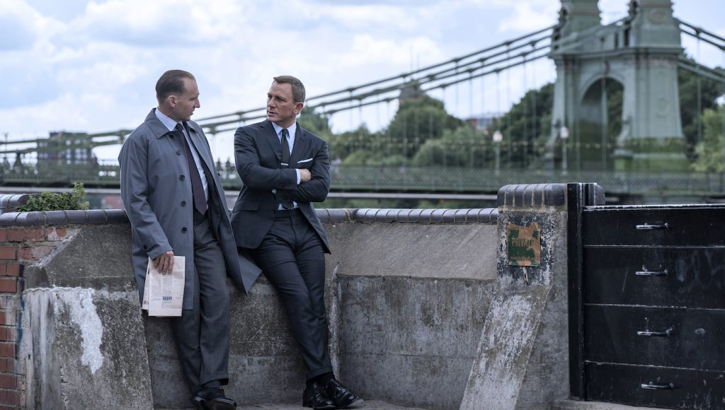 Ralph Fiennes stars as M and Daniel Craig as James Bond in NO TIME TO DIE, an EON Productions and Metro-Goldwyn-Mayer Studios film. Credit: Nicola Dove © 2021 DANJAQ, LLC AND MGM. ALL RIGHTS RESERVED.
