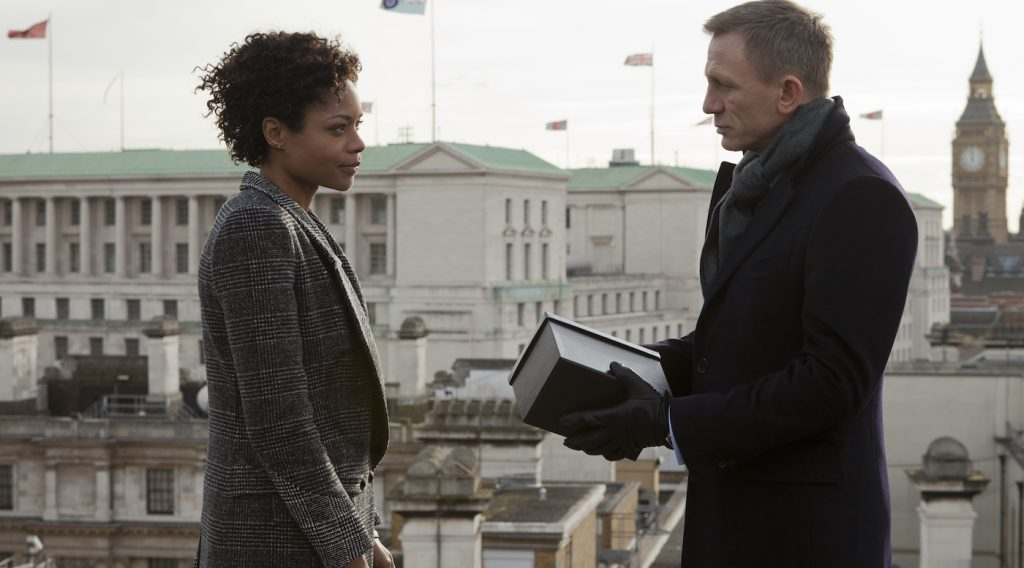 Eve (Naomie Harris) presents Bond (Daniel Craig) with a gift from M in Metro-Goldwyn-Mayer Pictures/Columbia Pictures/EON Productions' action adventure SKYFALL. Photo by Francois Duhamel.