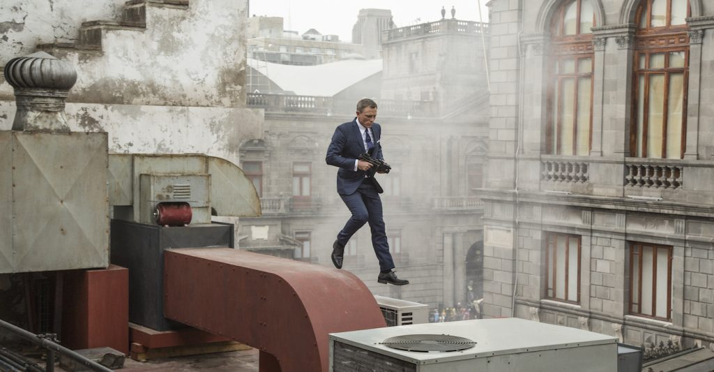 Bond (Daniel Craig) runs along the rooftops in pursuit of Sciarra in Mexico City in Metro-Goldwyn-Mayer Pictures/Columbia Pictures/EON Productions' action adventure SPECTRE. Photo by Jonathan Olley.