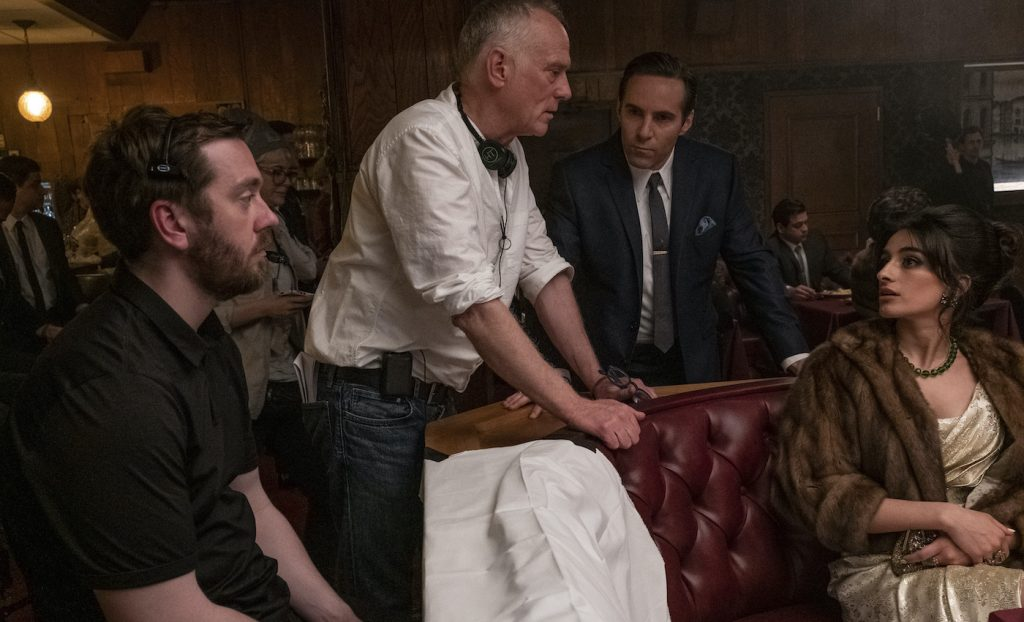 """Caption: (L-r) Director ALAN TAYLOR, ALESSANDRO NIVOLA and MICHELA DE ROSSI on the set of New Line Cinema and Home Box Office's mob drama """"THE MANY SAINTS OF NEWARK,"""" a Warner Bros. Pictures release. Photo Credit: Barry Wetcher"""