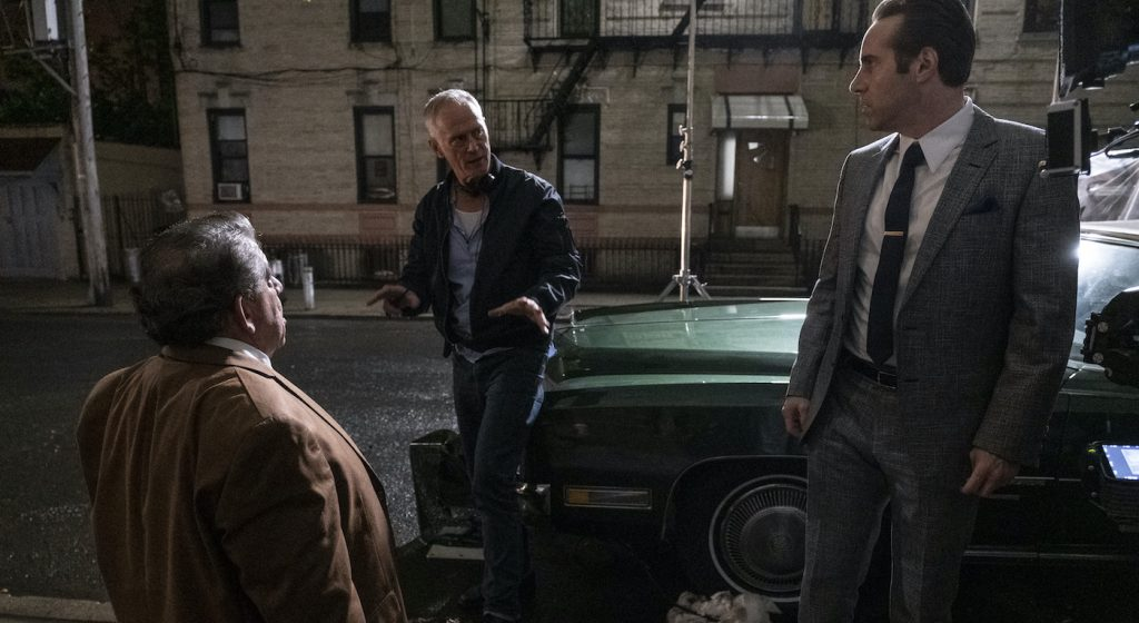 """Caption: (L-r) JOEY COCO DIAZ, director ALAN TAYLOR and ALESSANDRO NIVOLA on the set of New Line Cinema and Home Box Office's mob drama """"THE MANY SAINTS OF NEWARK,"""" a Warner Bros. Pictures release. Photo Credit: Barry Wetcher"""
